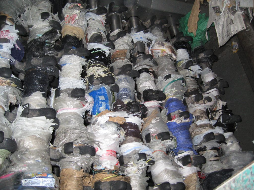 plastic bags and masks stuck in recycling equipment