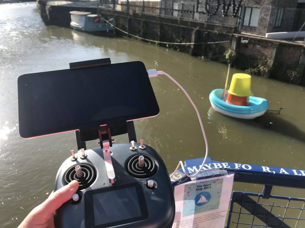 Ikea floating plastic river cleanup boat with controller