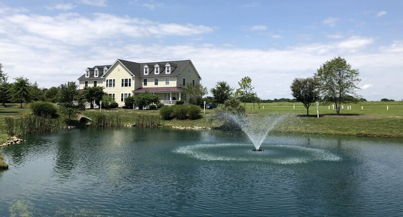 stormwater runoff management pond with fountain
